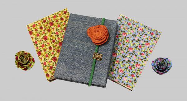 llibretes i roses del taller d'arrels