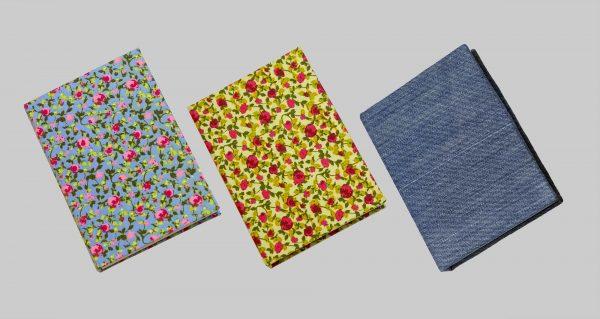 llibretes folrades amb tela al taller d'Arrels
